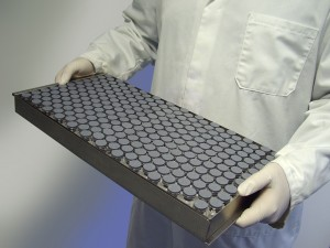 Holding a tray of vials